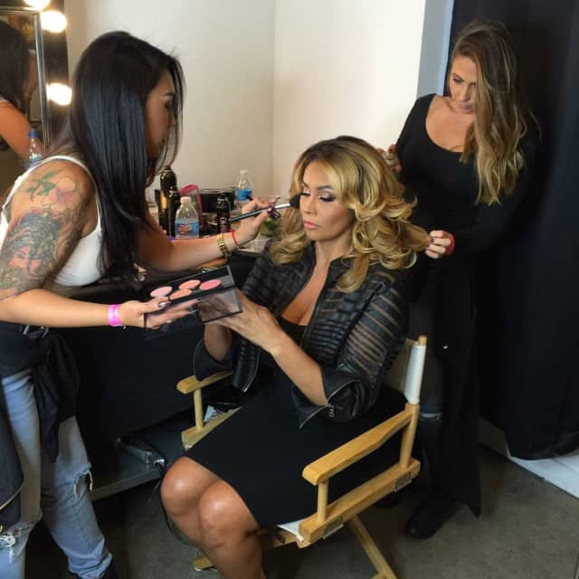 Rebecca Martin, a freelance makeup artist who grew up in Ringwood and now lives in Fair Lawn, puts makeup on Somaya Reece for the filming of Bravo TV's new reality show, First Family of Hip Hop.