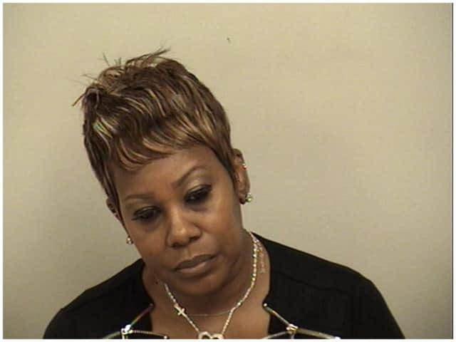Regina Murphy-Dixon of Greenwich was arrested for stealing a $900 Burberry handbag from a Westport store.