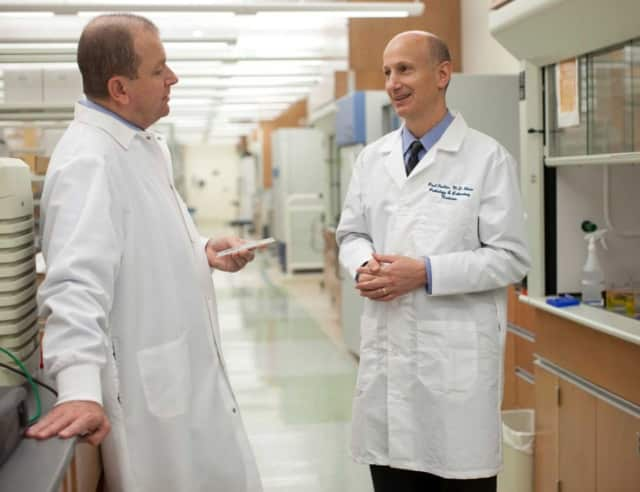 Western Connecticut Health Network doctors Cristiano Ferlini, left, and Paul Fiedler, are two authors of a new study that links a common virus with most cancers.