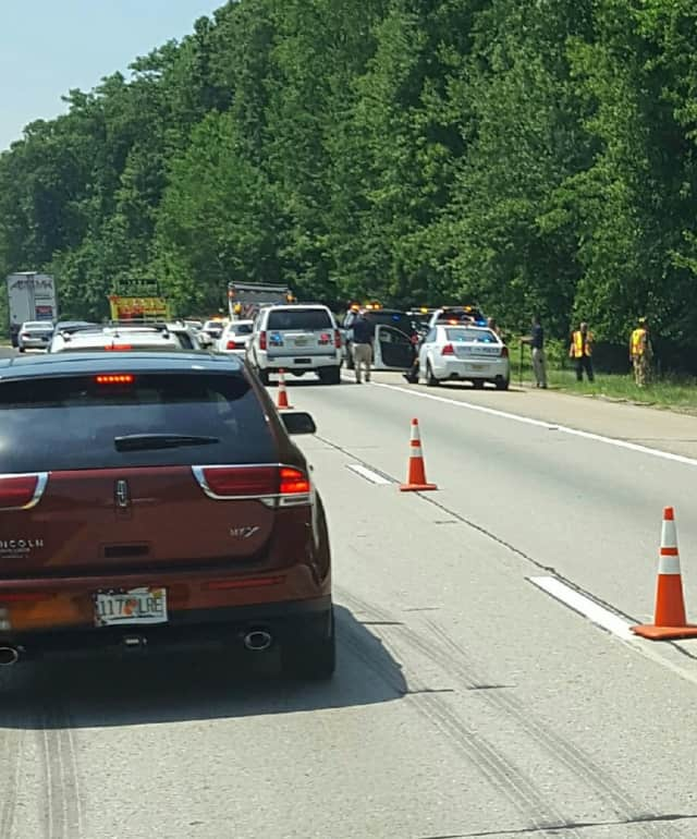 One lane remained open around noon Monday.