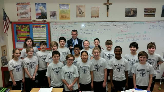 "Mike Meade, a fifth grade teacher at Resurrection School in Rye was honored last month as an ""Outstanding Teacher'' by the Archdiocese of New York. Meade celebrated his recent award with Resurrection students."