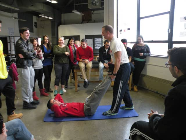 Rich Snedaker demonstrated how to best prepare athletes for events as well as effective ways to stretch out muscle groups and develop optimal range of motion.