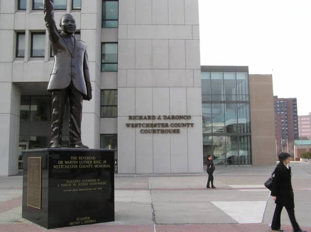 A person threw a suspicious white powder around two statues in front of the Westchester County Courthouse on Wednesday.