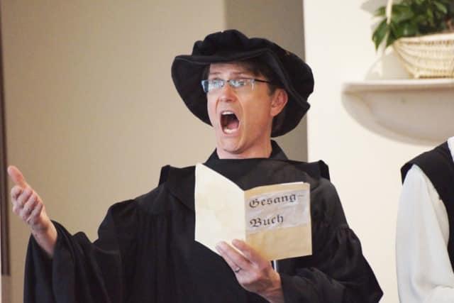 Richard Weidlich portrays Protestant reformer Martin Luther.