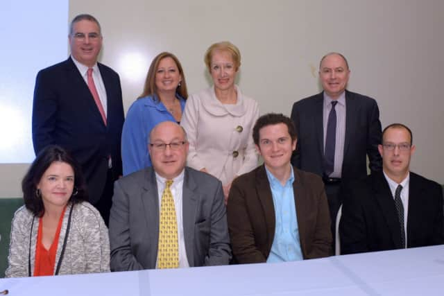 Seated, from left, political forum panelists Beth Fouhy, Steven Greenberg, Adam Edelman and Lane Filler. Standing, from left, BCW Executive Vice President John Ravitz; Board Member Taryn Duffy, President Marsha Gordon; and Board Member George Lence.
