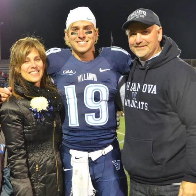 John Robertson and his parents