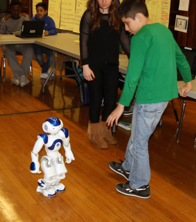 This robot from the Lower Hudson Regional Information Center is visiting with sixth-graders at Eastview Middle School in White Plains.