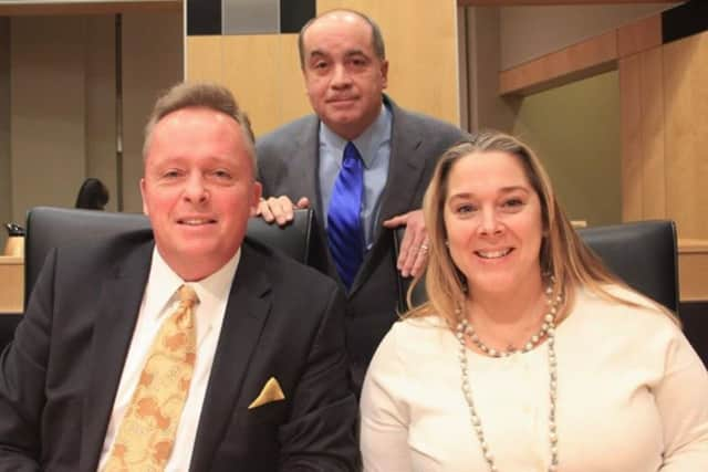 Pictured, from left are Legislators Vincent D. Tyer III, Charles J. Falciglia and Laurie Santulli.