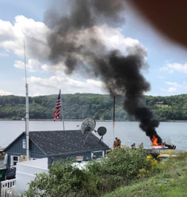 A boat caught on fire at the Brass Anchor Marnia.