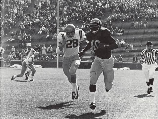 Ron Johnson was a record-setting halfback at the University of Michigan. In this 1967 game against Navy, he rushed for 270 yards.