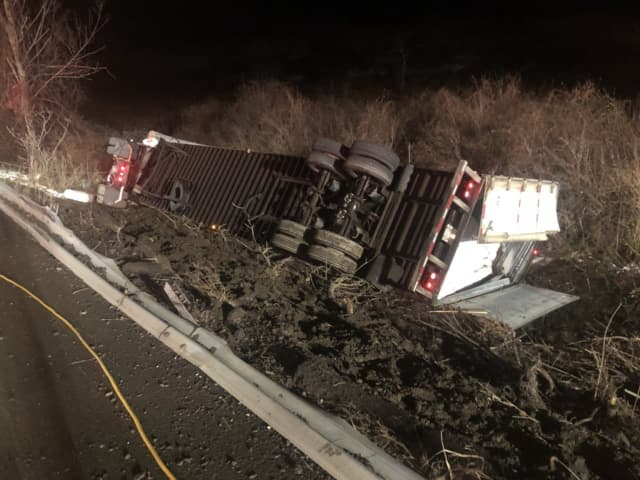 A tractor-trailer flipped on Route 22 in Northeast when the driver attempted to avoid a collision.