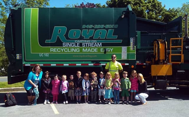"""""""Driver Rob"""" brought his Royal Carting truck to Acorns to Oaks Early Childhood Academy for a touch-a-truck event. The company is pairing with the local Chamber of Commerce for an e-recycling event next week."""