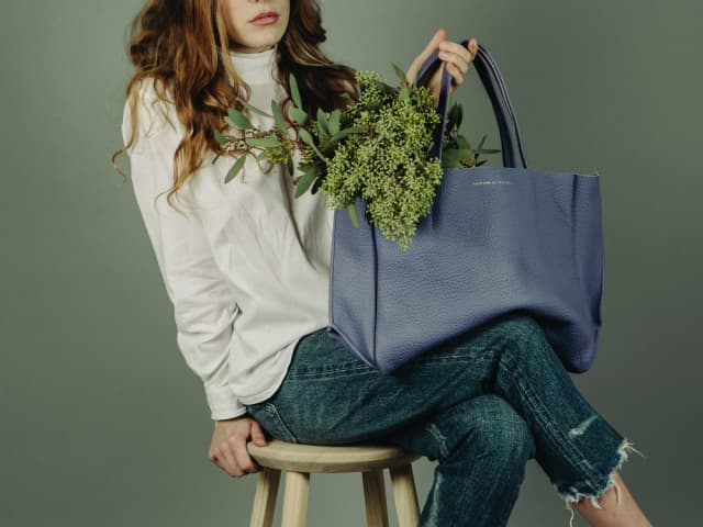 The Buffalo Sideways Tote by Ampersand as Apostrophe, pictured here in wren, $680.