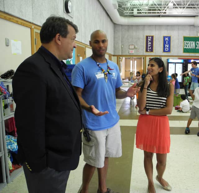 State Sen. George Latimer, left, talks with John Rice, Rye Y Camp, family and teen director, and board member Uma Khemlani during his recent visit to the camp.