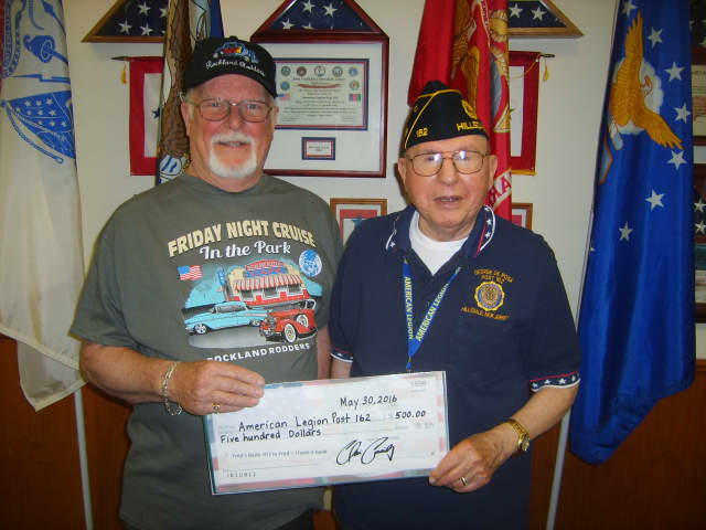 Phil Langner presenting check to Past Commander George DeRosa