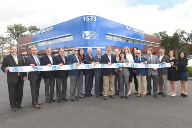Trustees, doctors and staff from Valley Medical Group's new location on Route 23 North in Wayne cut the ribbon on a new urgent care and multispecialty practice.