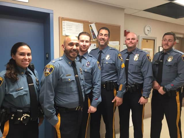 Members of the Saddle Brook Township Police Department stand together.