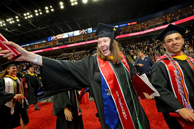 "Theresa ""T"" Fletcher, Sacred Heart University class of 2017 president, celebrates after the undergraduate commencement at Webster Bank Arena in Bridgeport on Sunday."