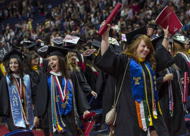 Graduates cheer at Sacred Heart University's undergraduate commencement exercises on May 15 at the Webster Bank Arena in Bridgeport.