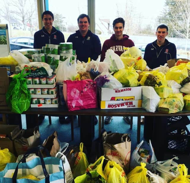 From left, Stepinac High School seniors Nick D'Ambrosio, John Walsh, David Markolovic and Gio Corelli with the final drop off of food donations to Lifting Up Westchester, as part of the school's annual massive SOUPer Bowl food drive.