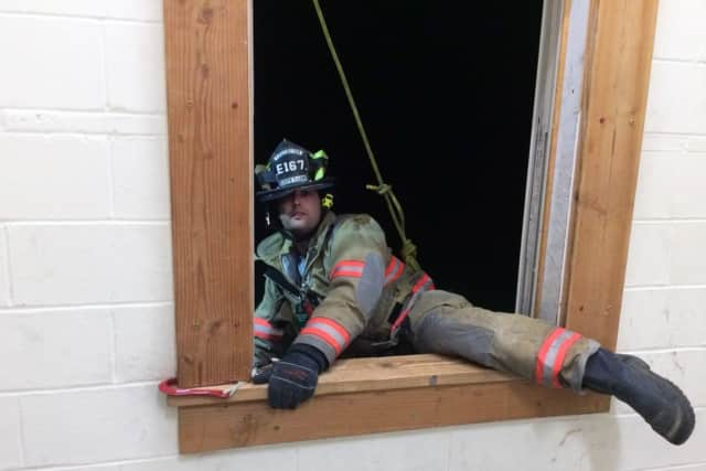 South Salem firefighter John Riina practices a bailout safety technique. The South Salem Fire Department and the Vista Fire Department will both be hosting Open Houses on Saturday.