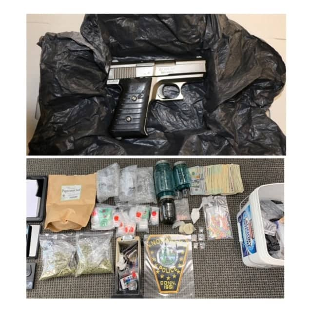 The drugs and gun seized during the raid.