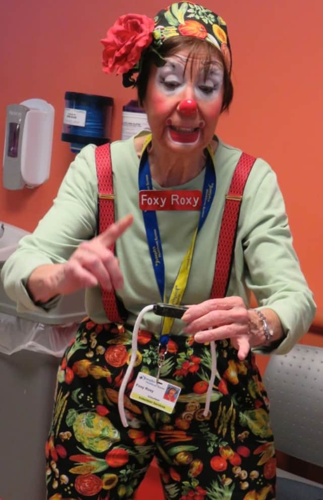 Ginnie Testo as Foxy Roxy performs at St. Joseph's Hospital.
