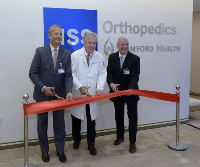 """From left: Louis A. Shapiro, President and CEO of Hospital for Special Surgery; Dr. Charles """"Chip"""" Cornell, Chair of the Department of Orthopedic Surgery at Stamford Health; and Brian G. Grissler, President and CEO, Stamford Health."""