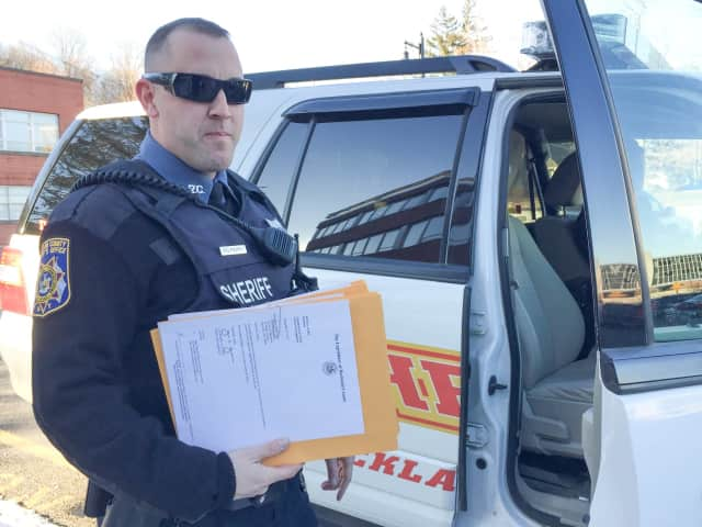 Rockland County Sheriff's Officer Steven Perry prepares to deliver the 2018 tax warrants to Rockland's five towns.