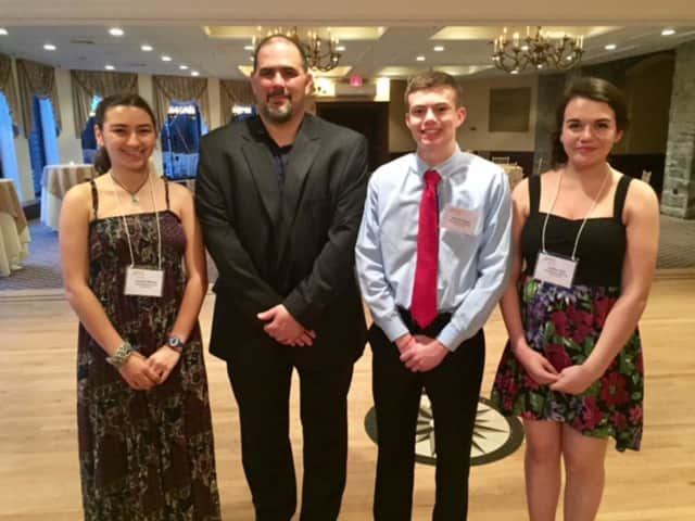 Chris Graziano (second left), vice president of SUEZ operations in New York, with SUEZ-NAWC scholarship winners Jessica Minker of North Rockland High School, Daniel Henry of Tappan Zee High School and Caitlin Holt of Pearl River High School.