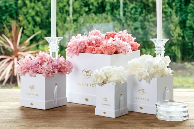 Saaya Roses offers hat-style boxes filled with real Ecuadorian roses that are designed to last one year. Courtesy Saaya Roses.