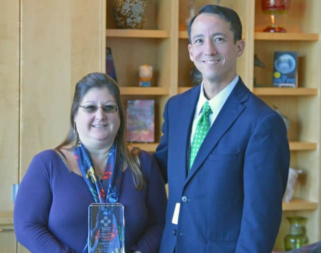 Cathi Kellett receives congratulations from Griffin Hospital Vice President of Accountable Care and General Counsel Todd Liu after being named Advocate of the Year by Safe Kids Connecticut.