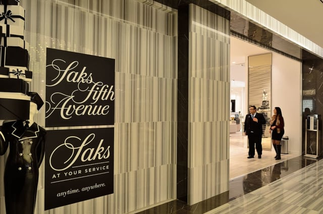 A victim said that she was notified the Saks fraud department that a purchase had been made for a woman's coat for $4.311.10 the day before on the credit card.