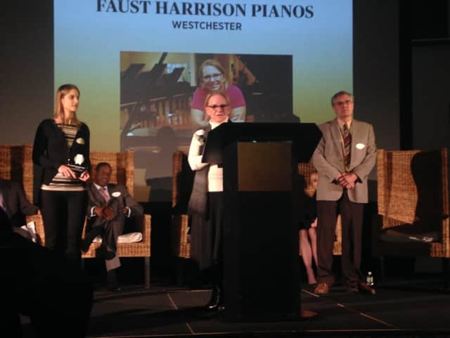 Sarah Faust, president of Faust Harrison Pianos (center), accepts award honoring her firm as one of the most outstanding family-owned businesses in Westchester.