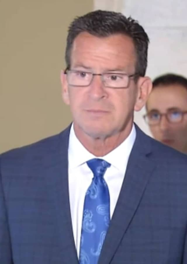 Gov. Dannel Malloy answers questions about GE during a press conference Monday.