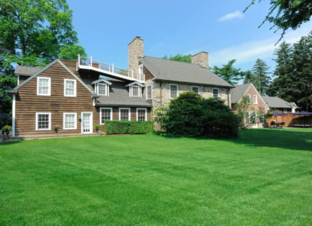 The North Stamford residence, sited on 2.6 acres, boasts a meticulous renovation while still maintaining many original features and antique qualities.