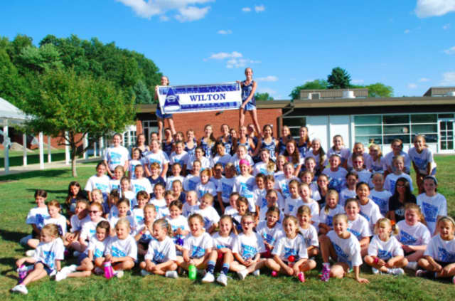 The cheerleaders of Wilton High School recently ran a cheer camp for grade school girls.