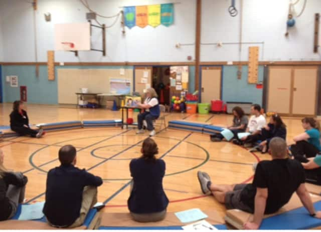 """Christine Wickel, Furnace Woods PE teacher delivers her """"Frame the Game"""" workshop to fellow physical education teachers in the region."""