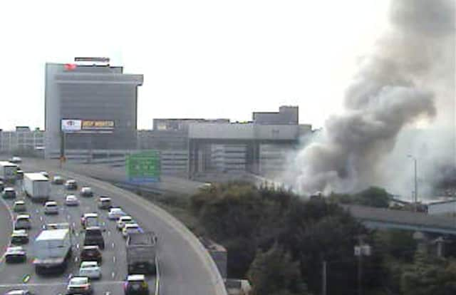 Smoke is visible from I-95 near Pembroke Street in Bridgeport due to a fire in an empty factory.