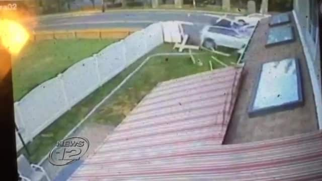 A security camera image of the driver smashing through an Eastchester fence before striking the house.