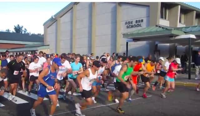 Runners take off from the starting line at the Sam Elpern Half Marathon in Norwalk.