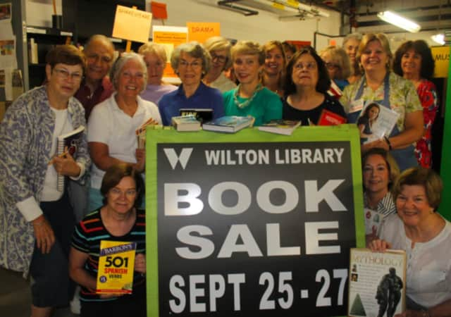 Wilton Library volunteers prepare for the fall fundraiser book sale Sept. 25-27.