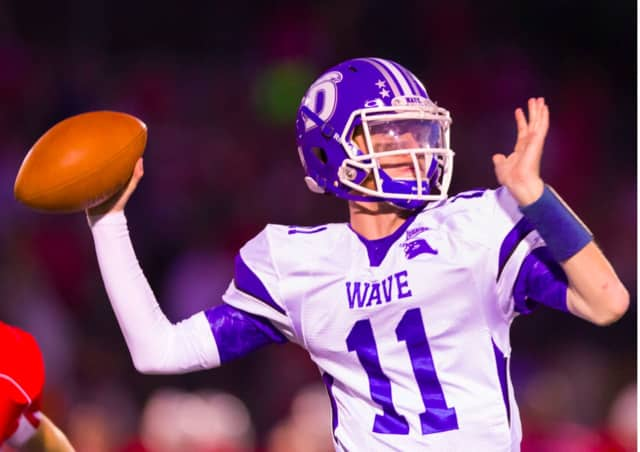 Darien High School quarterback Tim Graham leads the Blue Wave to the state championship game next week.