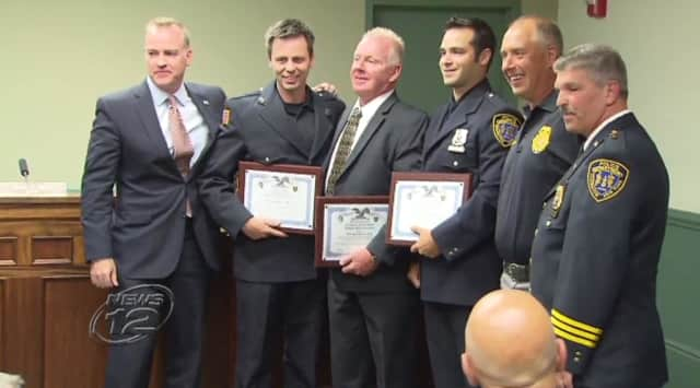 Three Irvington Police officers and the Irvington Fire Chief were honored for helping to stop a domestic dispute in April.