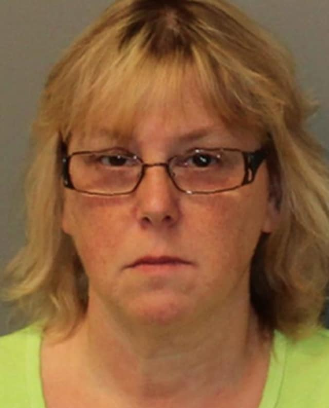 Former corrections employee Joyce Mitchell was sentenced to up to seven years in prison for helping two convicted murderers escape from an upstate prison.