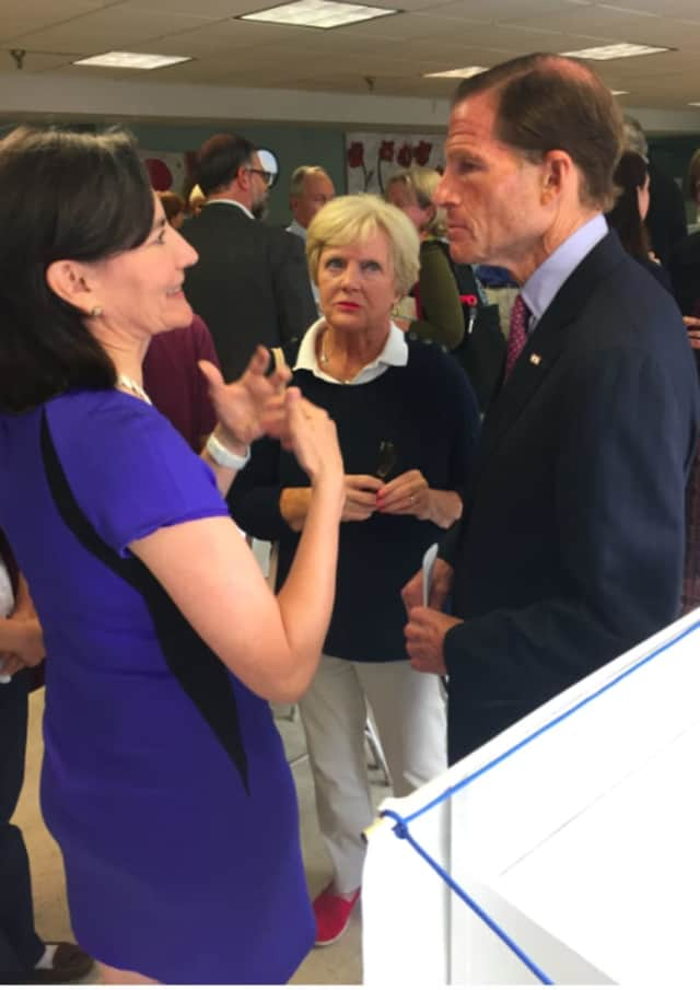 U.S. Sen. Richard Blumenthal listens as Catalina Samper Horak speaks after a discussion on the Syrian refugee crisis while Ginny Fox, center, looks on. He spoke at Neighbors Link in Stamford on Monday morning.