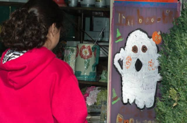 Children have been painting spooky images on Scarsdale storefronts at Halloween for several years.