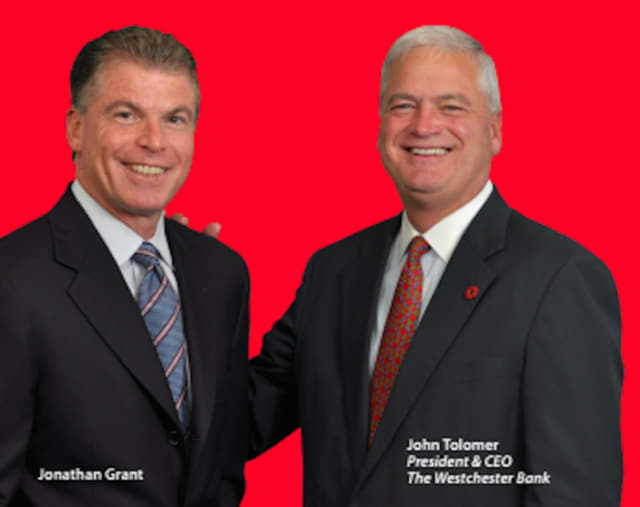 Jonathan Grant, left, turned to The Westchester Bank and John Tolomer to his banking needs when he wanted to expand his auto dealership portfolio in Yonkers.