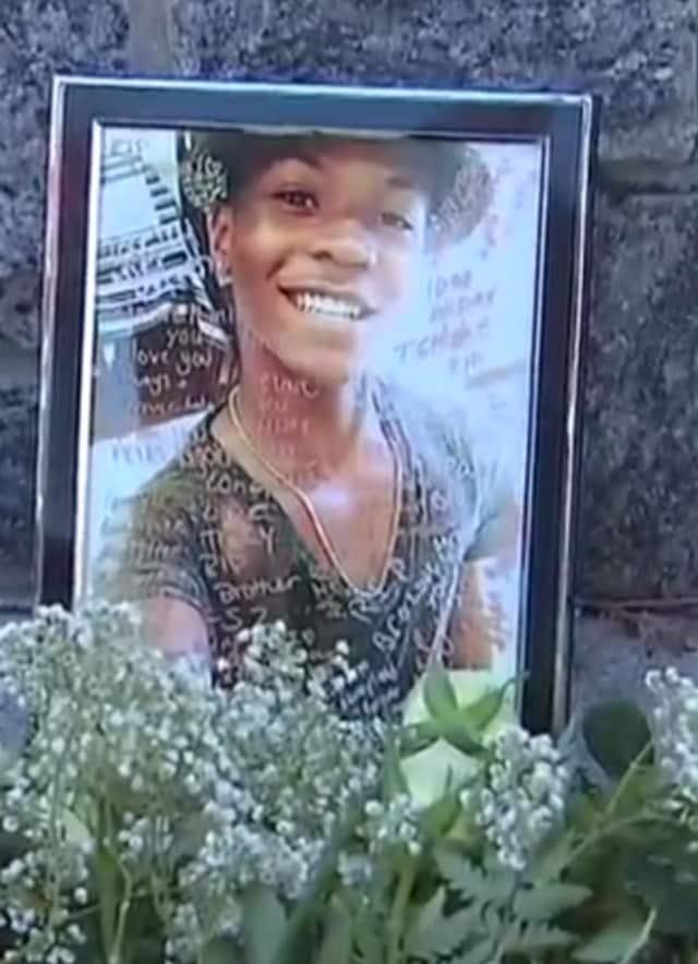 A photograph of Tahj Robinson in an impromptu memorial set up near Barhardt Park by friends of the slain teen.
