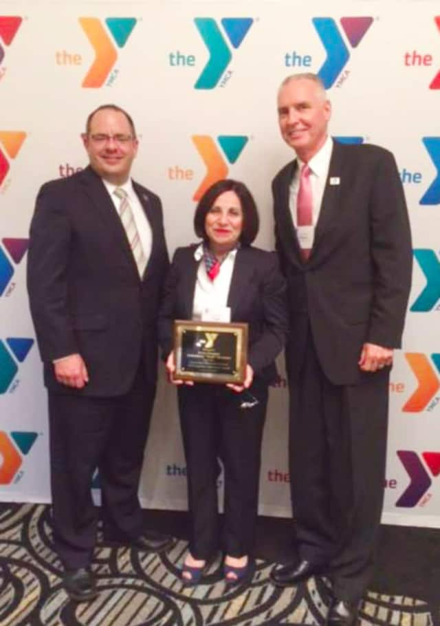 "Connecticut Alliance of YMCAs Executive Director John Cattelan, left, Sen. Toni Boucher , and Riverbrook Regional YMCA CEO Bob McDowell., right. The Connecticut Alliance of YMCAs has named Sen. Boucher its ""Legislator of the Year."""